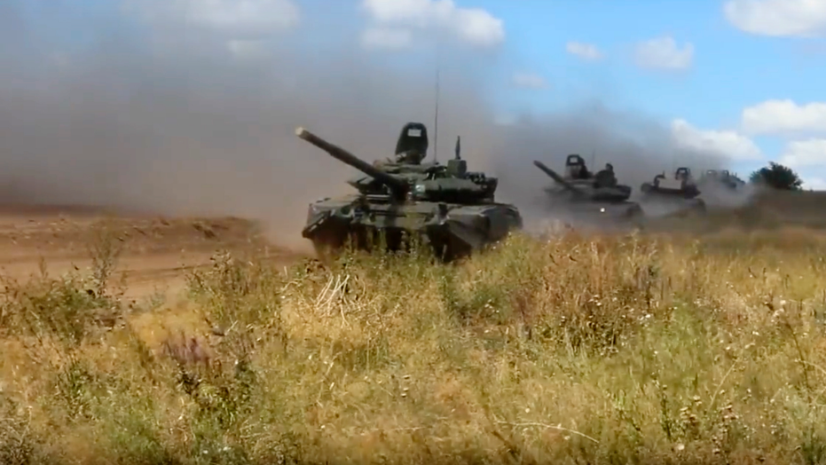 In this photo taken from video provided by Russian Defense Ministry Press Service on Tuesday, Sept. 11, 2018, tanks roll during the military exercises in the Chita region, Eastern Siberia, during the Vostok 2018 exercises in Russia. Russia's military chief of staff says that the military exercises expected to be the biggest in three decades, will involve nearly 300,000 troops. (Russian Defense Ministry Press Service pool photo via AP)