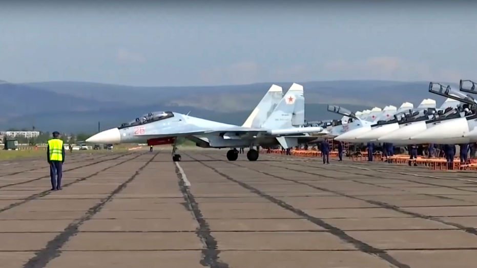 In this frame grab taken from video,  provided by the Russian Defense Ministry Press Service on Tuesday, Sept. 11, 2018, a Russian prepares to take off during the military exercises in the Chita region, Eastern Siberia, during the Vostok 2018 exercises in Russia. Russia's military chief of staff says that the military exercises expected to be the biggest in three decades, will involve nearly 300,000 troops. (Russian Defense Ministry Press Service pool photo via AP)
