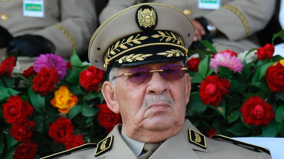 FILE - In this Sunday, July 1, 2018 file picture Algerian chief of staff Gen. Ahmed Gaid Salah presides a military parade in Algiers, Algeria. Heads have been rolling in the Algerian army, the North African nation's most respected institution, and in other security services, with generals in top posts fired _ without explanation _ at a rate never before seen. (AP Photo/Anis Belghoul, File)
