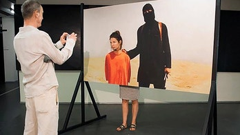 """Pic shows: The ISIS artwork on show at the festivalAn art installation where visitors are encouraged to have a photo taken next to an Islamic State terrorist waiting to behead them has been blasted by politicians.The artwork, which is part of an exhibition at the Gogbot art and music festival in the Eastern Dutch city of Enschede, features a full-size picture of a so-called Islamic State (IS) terrorist dressed entirely in black printed on a wooden board.Next to the IS terrorist, who is seen holding a knife, sits his victim dressed in an orange jumpsuit down on his knees shortly before being beheaded.The face of the victim is however cut out of the board, which allows visitors to the art exhibition to pose for a picture as an IS victim.The controversial artwork called """"phantom pain"""" was created by 22-year-old Anne Bothmer, who argued that """"lorries driving into crowds, bombings and shootings"""" caused a """"massive stream of irrational reactions.""""Bothmer wrote: """"As a spectator of these attacks we do not want to experience it, but we want to be part of it. The overarching tone of the messages within the aftermath amplifies a feeling of collective victimisation by European citizens.""""However, in comparison there were only a few who were really present at the attacks and the rest of Europe only perceived them through cinematic and photographic imagery. By using a provocative approach, my work unites these traumatic events with our own hyper reality, whereby the spectator is able to review his or her position.""""Because, can you call yourself a victim when you were not being present at one of these terrorist attacks?""""As soon as the work was unveiled local politicians from different parties called for the removal of the IS artwork.Arjan Brouwer of Democratic Platform Enschede said: """"We call urgently upon the mayor to act and remove this element of Gogbot immediately from the event.""""This picture of genocide does not belong at this event and needlessly confront"""