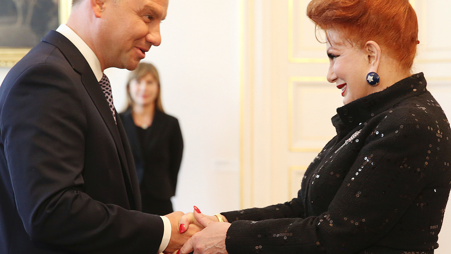Georgette Mosbacher, right, shakes hand with Polish President Andrzej Duda during a ceremony receiving her credentials as new United States ambassador to Poland, at the Belweder Palacein Warsaw, Poland, Thursday, Sept. 6, 2018.(AP Photo/Czarek Sokolowski)