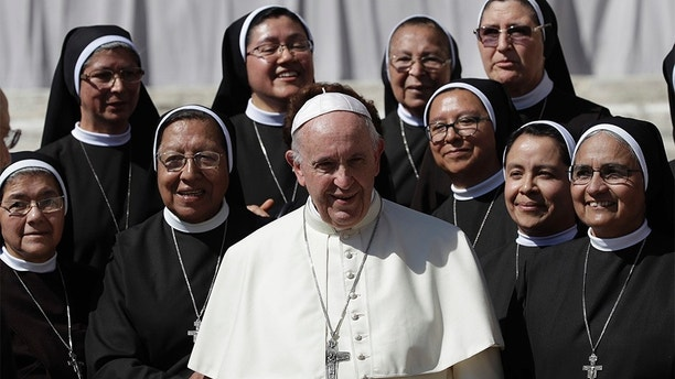 Pope Francis poses for a photo with nuns at the end of his general audience in St. Peter's Square at the Vatican Wednesday, Sept. 12, 2018. (AP Photo/Alessandra Tarantino)