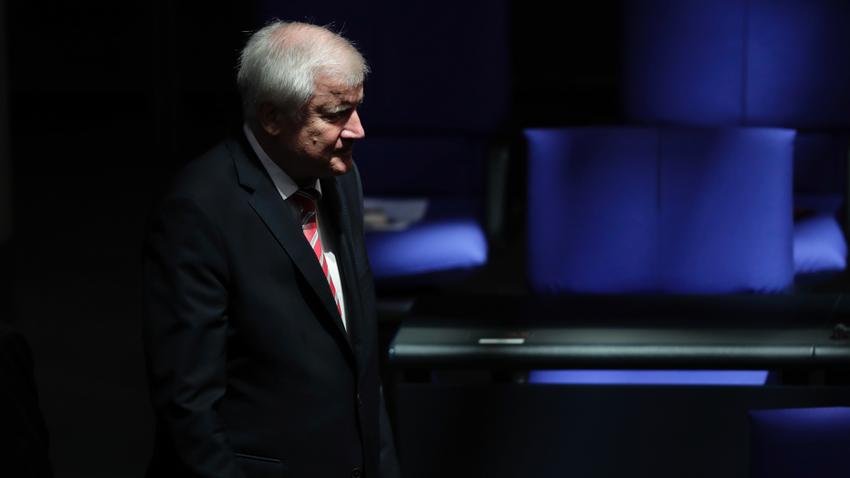 German Interior Minister Horst Seehofer arrives for a plenary session of the German parliament Bundestag about the budget 2019, in Berlin, Wednesday, Sept. 12, 2018. (AP Photo/Markus Schreiber)
