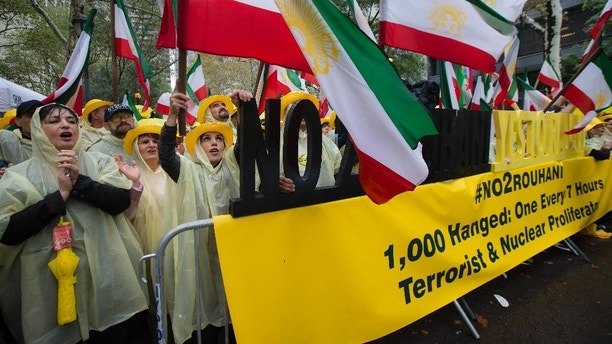 Protestors demonstrate against the government of Iran outside United Nations headquarters as the 69th session of the U.N. General Assembly convenes, Thursday, Sept. 25, 2014, in New York. (AP Photo/John Minchillo)