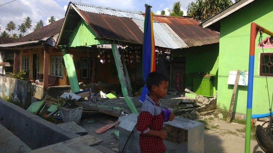 Tsunami sweeps away homes on Indonesian island of Sulawesi