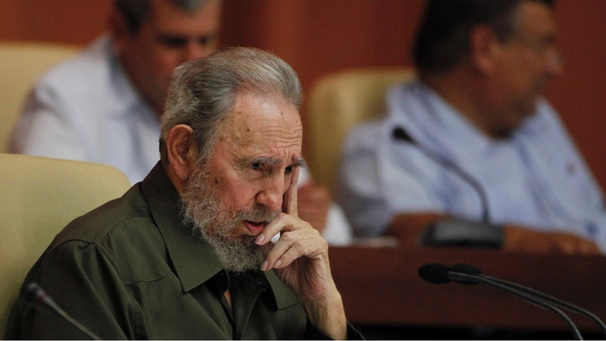 Fidel Castro attends a special session of parliament in his first official government appearance before lawmakers in four years in Havana, Cuba, Saturday Aug. 7, 2010.  Castro, who turns 84 on Aug. 13, is making near daily appearances in and around Havana after spending four years almost completely out of the public eye following emergency intestinal surgery that forced him to cede power to his younger brother Raul. (AP Photo/Javier Galeano)