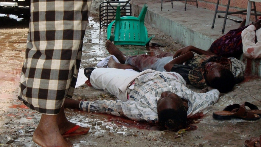 ** EDS NOTE GRAPHIC CONTENTS ** Dead bodies lie outside of the Muna Hotel in Mogadishu, Somalia, Tuesday Aug, 24, 2010. A suicide bomber and a gunman stormed the hotel in Somalia's capital on Tuesday, scores of people, including members of parliament died, a military spokesman said. (AP Photo)