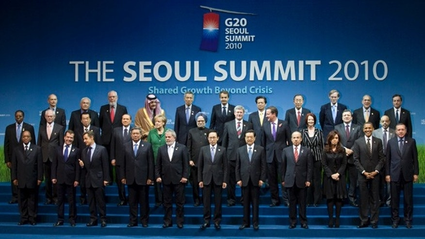 Leaders of the G20 as they pose for the official family photo at the G20 Summit in Seoul, South Korea, Friday, Nov. 12, 2010. (AP Photo/The Canadian Press,Adrian Wyld)