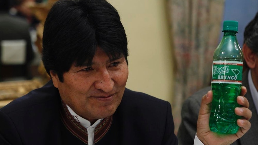 Bolivia's President Evo Morales holds up a bottle of Coca Brynco during a meeting with foreign press at the government palace in La Paz, Bolivia, Friday, Jan. 14, 2011. Coca Brynco is a Bolivian soda made with coca leaves, Morales said. (AP Photo/Juan Karita)