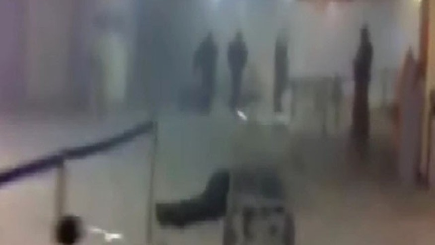 A victim of a bomb explosion is seen at Moscow's Domodedovo airport in this still image taken from mobile phone footage January 24, 2011.  A suicide bomber killed at least 31 people and injured more than 130 on Monday at Moscow's Domodedovo airport, Russia's biggest.   REUTERS/Stanislav Grigoryev/Reuters TV  (RUSSIA - Tags: POLITICS CRIME LAW)
