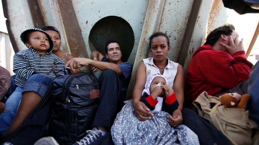 Central American migrants ride a northern bound train during their journey toward the US-Mexico border in Arriaga, in the state of Chiapas, Mexico, Thursday Feb. 3, 2011.  Migrants crossing Mexico to get to the U.S. have increasingly become targets of criminal gangs who kidnap them to obtain ransom money.  (AP Photo/Eduardo Verdugo)