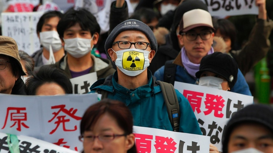 "Protesters hold placards during an antinuclear rally in Tokyo Sunday, March 27, 2011. Leaked water in Unit 2 of the Fukushima Dai-ichi plant measured 10 million times higher than usual radioactivity levels when the reactor is operating normally, Tokyo Electric Power Co. spokesman Takashi Kurita told reporters in Tokyo. The placards has a message that reads ""We don't need nuclear plant."" (AP Photo/Itsuo Inouye)"