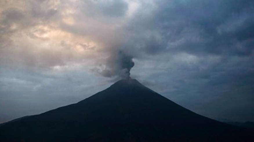 The Tungurahua Volcano spews ashes during an eruption as seen from Cotalo, Ecuador, Friday, April 29, 2011. The volcano, 136 kilometers, some 85 miles, southeast of Quito, has been active since 1999. (AP Photo/Dolores Ochoa)