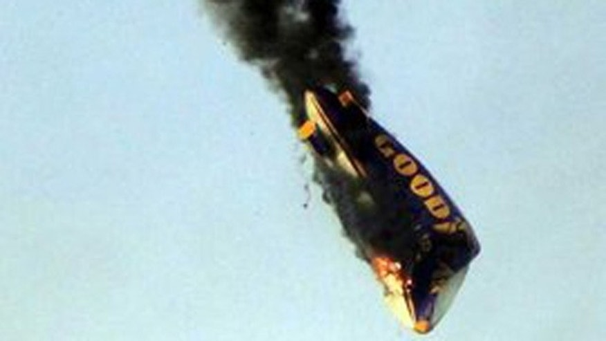 epa02778534 A Goodyear blimp crashes near the venue of the Hessentag festival in Oberursel, Germany, 12 June 2011.   The pilot Mike Nerandzic was killed but the three journalists on board managed to jump to safety when the airship caught fire as it was coming in to land. When the airship was just six meters from the above ground, the pilot told his passengers to jump while he tried to land safely. Once the three journalists leapt clear of the blimp it then climbed back up to 120 feet, but flames were seen engulfing the ship soon after.  EPA/STR