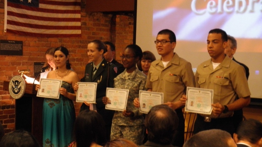Thirty five immigrants became U.S. citizens at a naturalization ceremony in Manhattan Friday. The ceremony, timed to honor the Fourth of July, included five military service men and women, among them Paola Sanchez (far left), a native of Colombia who is a member of the National Guard.