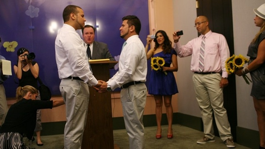 Marcos A. Chaljub, left, and Freddy L. Sambrano exchange vows at the Manhattan City Clerk's office  on the first day New York State's Marriage Equality Act goes into effect, on Sunday, July 24, 2011, in New York.   (AP Photo/Michael Appleton, Pool)
