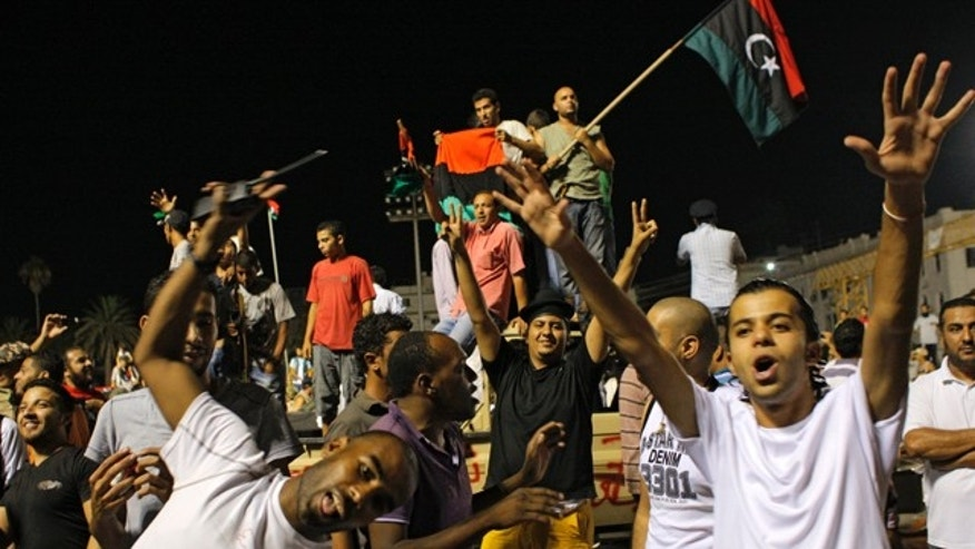 Aug. 24: Libyans celebrate overrunning Qaddafi's compound in Tripoli. Hundreds of Libyan rebels stormed Qaddafi's compound, charging wildly through the symbolic heart of the crumbling regime as they killed loyalist troops, looted armories and knocked the head off a statue of the besieged dictator.