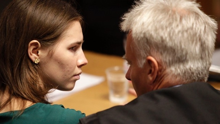 Amanda Knox, left, talks to her lawyer Carlo Dalla Vedova prior to an appeal hearing, at the Perugia court, central Italy, Monday, Oct. 3, 2011. The 24-year-old Knox looked tense as she entered a packed courthouse. She is expected to address the court in a final plea of her innocence. A verdict is expected later Monday. (AP Photo/Pier Paolo Cito)