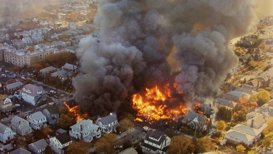 397324 01: The wreckage of American Airlines flight 587 burns November 12, 2001 in the Rockaway neighborhood of the Queens section of New York City, The Airbus A-300 passenger jet crashed shortly after takeoff, killing all 260 people on board and five people on the ground. (Photo by NYPD/Getty Images)
