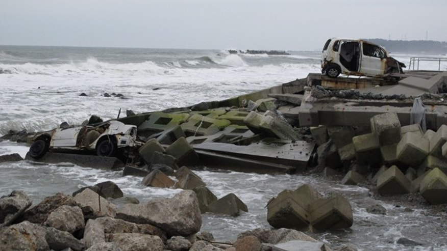 Wrecks of cars remain strewn along the coastline within the exclusion zone around Japan's Fukushima nuclear plant.