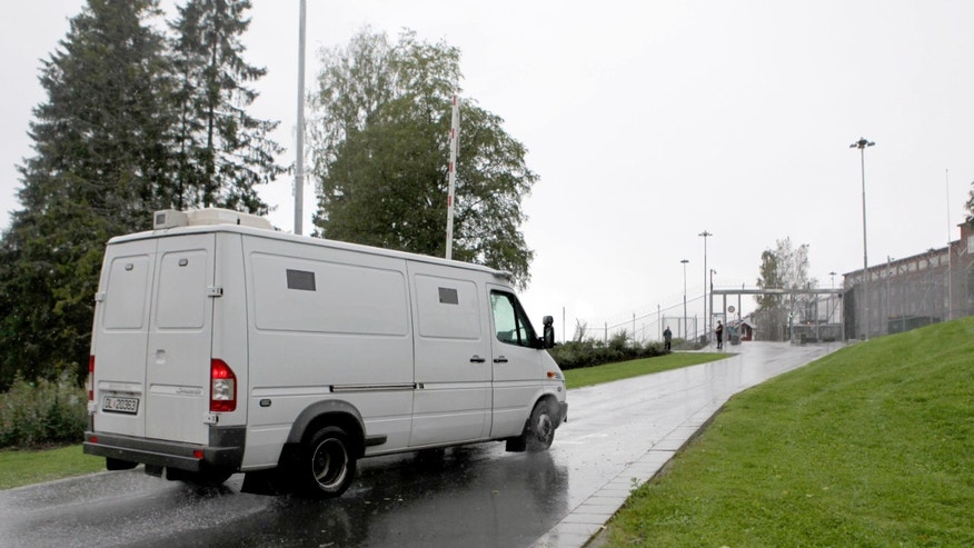 A police vehicle with terror charged Anders Behring Breivik arrives at  Ila Prison outside Oslo Norway Wednesday Aug. 22, 2012. The Norwegian right-wing extremist who admitted to bomb and gun attacks that killed 77 people last year will receive his judgment Friday in a court room custom built for his trial. (AP Photo/Ole Berg Rusten, NTB scanpix) NORWAY OUT