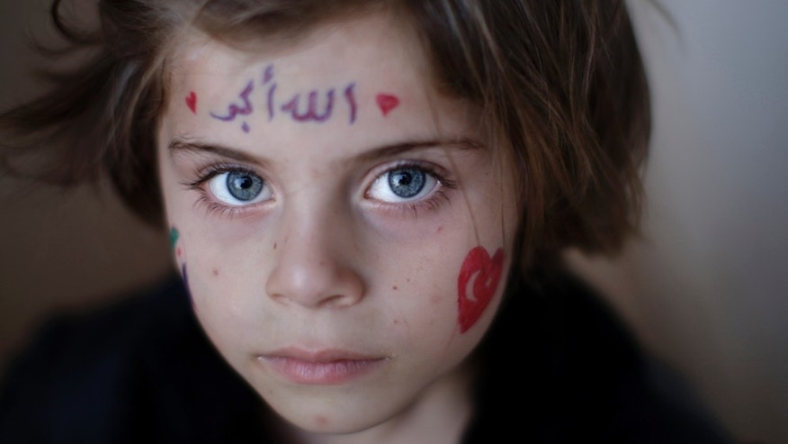 Aug. 31, 2012: A Syrian girl, Aya Abdulhay, 5, who fled her home in Aleppo with her family due to fighting between the Syrian army and the rebels, takes refuge at the Bab Al-Salameh border crossing.