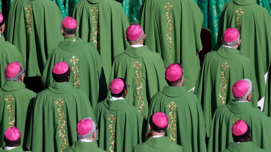 Bishops atend a mass celebrated by Pope Bemedict XVI marking the 50th anniversary of the Second Vatican Council, in St. Peter's Square at the Vatican, Thursday, Oct. 11, 2012. Benedict, after celebrating mass, will greet churchmen, including a dozen original Vatican II participants, re-enacting the great procession into St. Peter's that launched the council in 1962. . (AP Photo/Andrew Medichini)