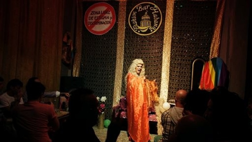 """In this Nov. 16, 2013 photo, Juan Felipe, 27, whose stage name is """"Angela Nefer,"""" performs at the Fashion Bar Habana, in Havana, Cuba. While many new entrepreneurs have failed, undone by a lack of supplies, a limited customer base and scarce resources, many of those who have succeeded have entered a glamorous world that disappeared after Fidel Castro's arrival in Havana put an end to the freewheeling 1950s. (AP Photo/Franklin Reyes)"""