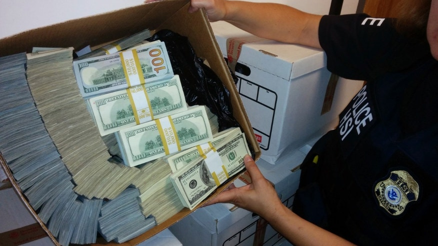 This photo provided by U.S. Immigration and Customs Enforcement shows a box of cash part of what was seized by Homeland Security Investigations in Los Angeles on Wednesday, Sept. 10, 2014. Federal authorities have arrested nine people and seized roughly $65 million in a crackdown on suspected drug money laundering in the fashion district of Los Angeles. (AP Photo/U.S. Immigration and Customs Enforcement )