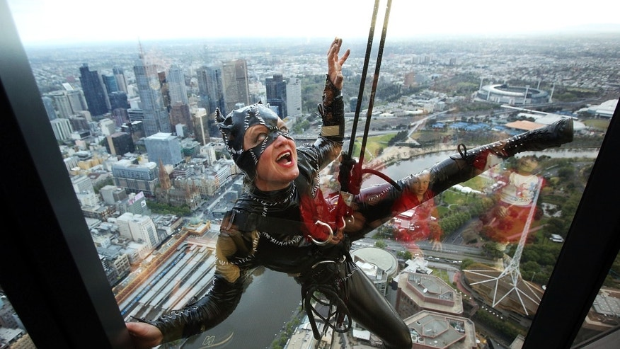 MELBOURNE, AUSTRALIA - OCTOBER 15:  Stuntwoman Rowena Davies scales the outside of the Eureka Tower dressed as Catwoman at Eureka Skydeck on October 15, 2014 in Melbourne, Australia.  (Photo by Graham Denholm/Getty Images)