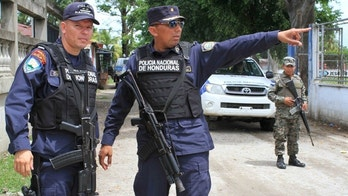 """Police captain Carlos Espinosa leads a patrol through Chamelecon. """"We are in Maras [gang] territory … an area that's a hotspot,"""" he said. (Photo: Nathaniel Parish Flannery/Fox News Latino)"""