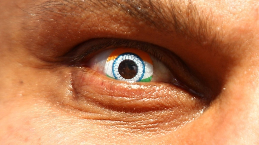 PERTH, AUSTRALIA - MARCH 06:  An Indian spectator shows his support by wearing Indian flag contact lenses during the 2015 ICC Cricket World Cup match between India and the West Indies at WACA on March 6, 2015 in Perth, Australia.  (Photo by Paul Kane/Getty Images)
