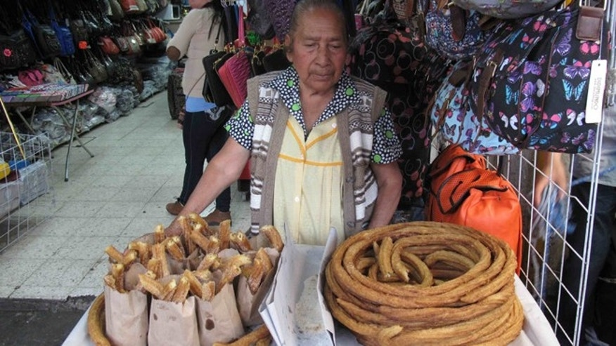 Churros for sale outside a bag shop. (Photo: Nathaniel Parish Flannery/Fox News Latino)