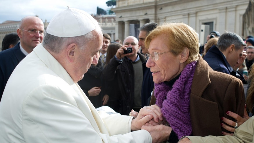 "In this Feb. 5, 2014 photo, Pope Francis meets Argentine Lidia Guerrero in St. Peter's Square at the Vatican. The pope, an Argentine native, told Guerrero he knew all about her son, who has been on death row in Texas for 19 years. ""I've prayed so much for that young man from Cordoba,"" she says Francis told her, referring to the hometown of Victor Hugo Saldano. The short meeting left Guerrero with more hope than she has felt in years about the future of her son, who she says is guilty of murder but has been driven to insanity on death row in Texas. (L'Osservatore Romano/Pool Photo via AP)"
