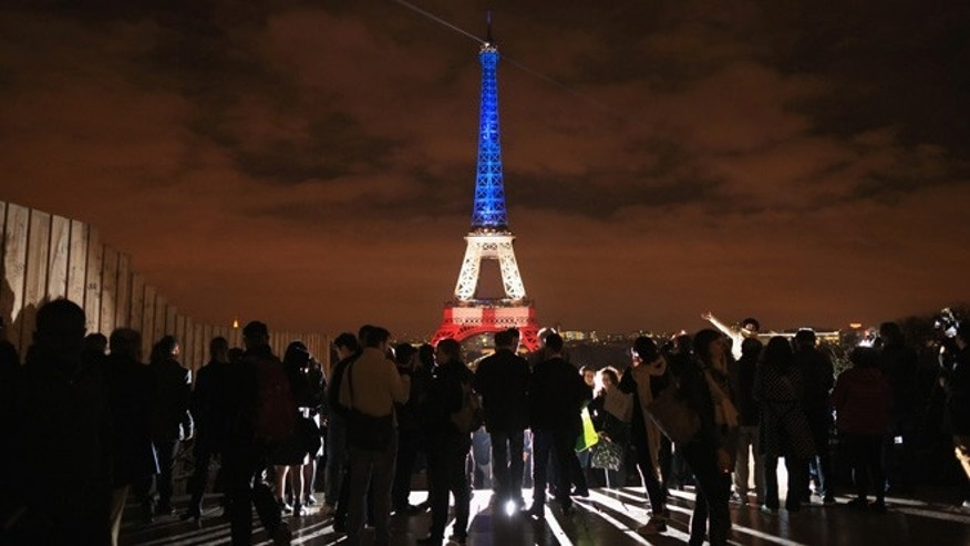 PARIS, FRANCE - NOVEMBER 16:  The Eiffel Tower is illuminated in Red, White and Blue in honour of the victims of Friday's terrorist attacks on November 16, 2015 in Paris, France. Countries across Europe joined France today to observe a one minute-silence in an expression of solidarity with the victims of the terrorist attacks, which left at least 129 people dead and hundreds more injured.  (Photo by Christopher Furlong/Getty Images)