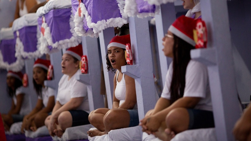 Prisoners perform during a Christmas decorating contest inside their cell at the Nelson Hungria prison in Rio de Janeiro, Brazil, Thursday, Dec. 10, 2015. Each cell of 50 women or more also put on a skit dramatizing Biblical stories, with many depictions of Jesus' life, as well as David and Goliath and Daniel in the lions' den, giving prison's would-be thespians their chance to shine. (AP Photo/Silvia Izquierdo)