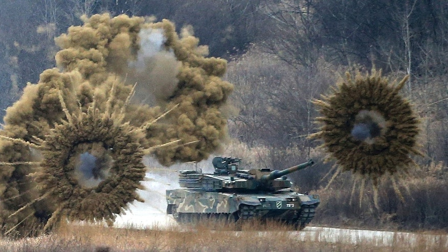 "Smoke bombs explode near a South Korean army K-2 tank during a live firing drill at a fire training field in Yangpyeong, South Korea, Thursday, Feb. 18, 2016. North Korean leader Kim Jong Un recently ordered preparations for launching ""terror"" attacks on South Koreans, a top Seoul official said Thursday, as worries about the North grow after its recent nuclear test and rocket launch. (Lim Hun-jung/Yonhap via AP) KOREA OUT"