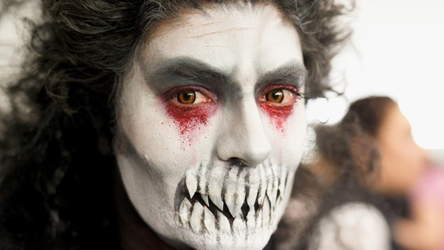 LORCA, SPAIN - MARCH 25:  A performer from the 'Paso Blanco' (White Group) poses for a portrait as he prepares his demon makeup before the Holy Friday biblical parade on March 25, 2016 in Lorca, in Murcia province, Spain. Lorca's parades recreate biblical scenes. They are well known for their horse chariot races and their handmade embroidered cloaks. Spain celebrates holy week before Easter with processions in most Spanish towns and villages.  (Photo by Pablo Blazquez Dominguez/Getty Images)