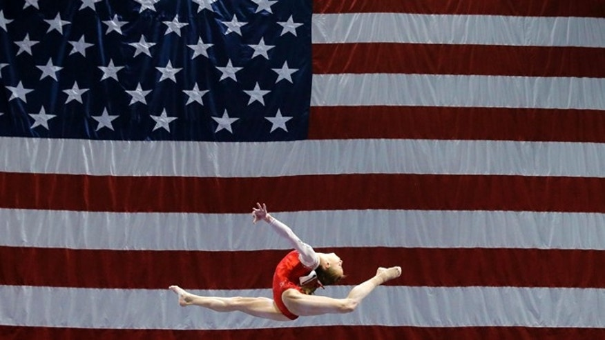 Madison Kocian competes on the balance beam during the U.S. women's gymnastics championships, Friday, June 24, 2016, in St. Louis. (AP Photo/Tony Gutierrez)