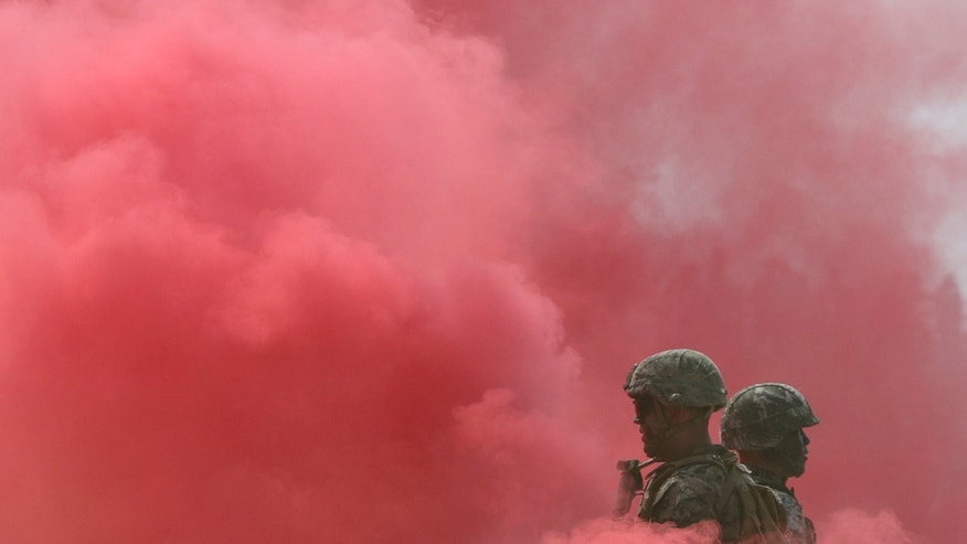"South Korea and U.S. Marines stand in smoke during the 66th Incheon Landing Operations Commemoration ceremony in Incheon, South Korea, Friday, Sept. 9, 2016. Incheon is the coastal city where the United Nations Forces led by U.S. Gen。 Douglas MacArthur landed in September, 1950 just months after North Korea invaded the South. North Korea said Friday it conducted a ""higher level"" nuclear warhead test explosion, which it trumpeted as finally allowing it to build ""at will"" an array of stronger, smaller and lighter nuclear weapons. It is Pyongyang's fifth atomic test and the second in eight months. (AP Photo/Lee Jin-man)"