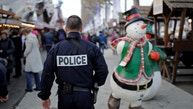 A French police officer patrols a Christmas market as emergency security measures continue on the Champs Elysees Avenue in Paris, France, December 20, 2016. REUTERS/Benoit Tessier - RTX2VW1A