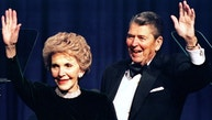 Former US President Ronald Reagan and his wife Nancy wave while attending a gala celebrating his 83rd birthday, February 3 in Washington - RTXFGJD
