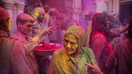An Indian widow smeared with colors play Holi at the Gopinath temple, in Vrindavan, 180 kilometers (112 miles) south-east of New Delhi, India, Thursday, March 9, 2017. Up to just a few years ago the festival was forbidden for Hindu widows. Like hundreds of thousands of observant Hindu women, they would have been expected to live out their days in quiet worship, dressed only in white, with their very presence being considered inauspicious for all religious festivities. (AP Photo /Manish Swarup)