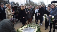 People lay flowers as they attend a ceremony commemorating the first anniversary of twin attacks at Brussels airport and a metro train in Brussels, Belgium, March 22, 2017.  REUTERS/Didier Lebrun/Pool - RTX3253P