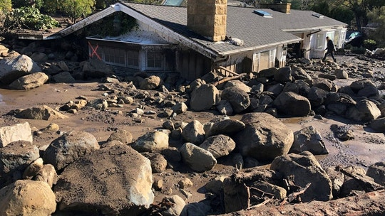 A damaged house is surrounded by large boulders and debris following mudslides due to heavy rains in Montecito, California, U.S. in this photo provided by the Santa Barbara County Fire Department, January 10, 2018.    Mike Eliason/Santa Barbara County Fire Department/Handout via REUTERS     ATTENTION EDITORS - THIS IMAGE WAS PROVIDED BY A THIRD PARTY.     TPX IMAGES OF THE DAY - RC1C42930310