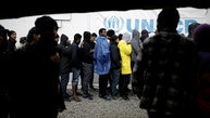 """Refugees and migrants line up to receive their lunch provided by the Greek authorities, at a makeshift camp next to the Moria camp on the island of Lesbos, Greece, November 30, 2017. REUTERS/Alkis Konstantinidis   SEARCH """"MORIA CAMP"""" FOR THIS STORY. SEARCH """"WIDER IMAGE"""" FOR ALL STORIES. - RC1BA4A159C0"""