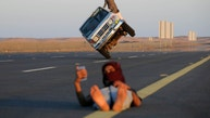 """Saudi men perform a stunt known as """"sidewall skiing"""" (driving on two wheels) as a youth takes a selfie in Tabuk, Saudi Arabia March 11, 2018. REUTERS/Mohamed Al Hwaity     TPX IMAGES OF THE DAY - RC1A443944B0"""