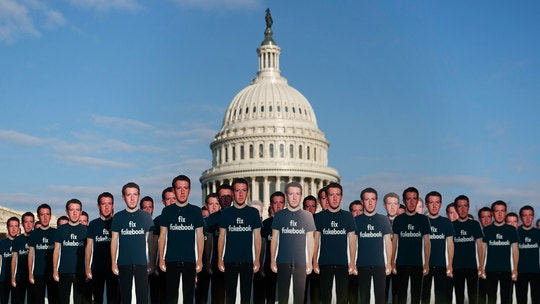"Life-sized cutouts depicting Facebook CEO Mark Zuckerberg wearing ""Fix Fakebook"" T-shirts are displayed by advocacy group, Avaaz, on the South East Lawn of the Capitol on Capitol Hill in Washington, Tuesday, April 10, 2018, ahead of Zuckerberg's appearance before a Senate Judiciary and Commerce Committees joint hearing. (AP Photo/Carolyn Kaster)"