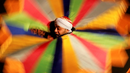 An Egyptian dancer performs the Tanoura, an Egyptian version of Sufi dance, during the holy fasting month of Ramadan, at Al Ghouri Palace in the old Islamic area of Cairo, Egypt June 7, 2018. Picture taken June 7, 2018.  REUTERS/Amr Abdallah Dalsh     TPX IMAGES OF THE DAY - RC1293E48300