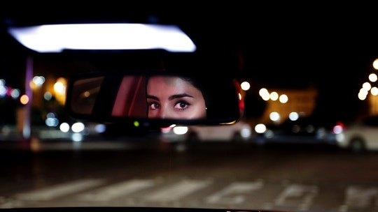 FILE - In this Sunday, June 24, 2018 file photo, Hessah al-Ajaji drives her car down the capital's busy Tahlia Street after midnight for the first time, in Riyadh, Saudi Arabia. Saudi women are driving freely for the first time after years of risking arrest if they dared to get behind the wheel. And with the ban now lifted, a new opportunity has emerged: Working as drivers. (AP Photo/Nariman El-Mofty, File)